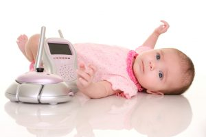 baby with baby monitor as a safety concept