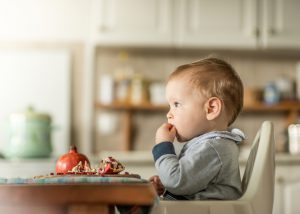 Baby eating a pomegranate fruit